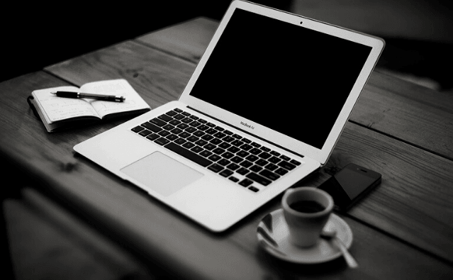 Featured Image - Laptop and cup on a desk