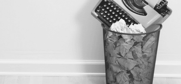 Featured Images - Typewritter in a waste basket full of paper