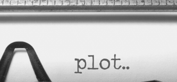 Featured Images - Close up of a typewriter paper with the word plot.. typed