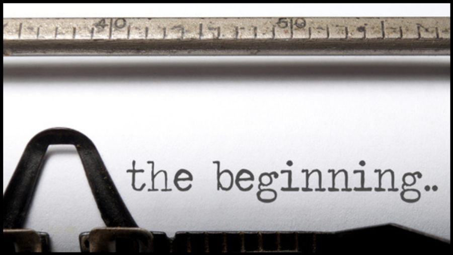 """Close up of a typewriter with the words """"The Beginning"""" typed"""