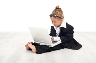 Little girl playing career woman role
