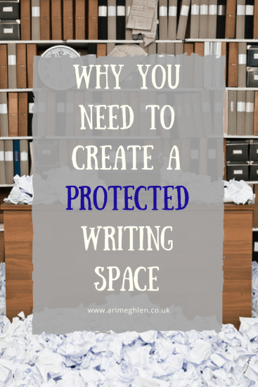 banner why you need to create a protected writin space. photo of a desk covered in paper