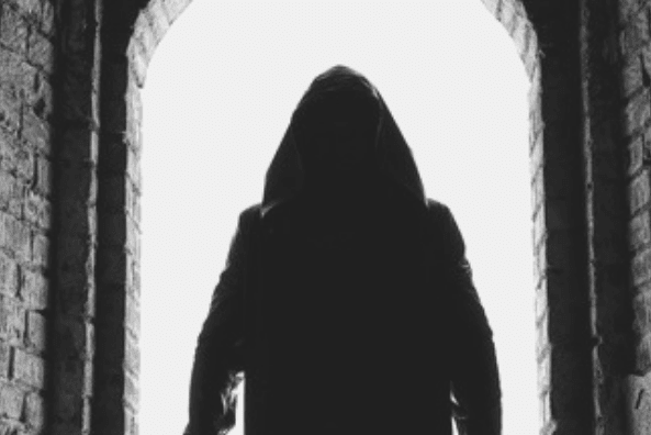 Featured Images - Shadowy hooded figure standing in a doorway