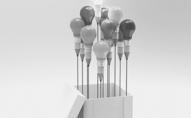 Featured Images - A cluster of lightbulbs that turn into pencils at the narrow end. They all have strings attached and are coming out of a box like balloons. Image bought from DepositPhotos