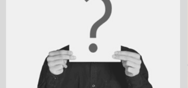 Featured Images - Man holding up a piece of paper in front of his face with a question mark on it.