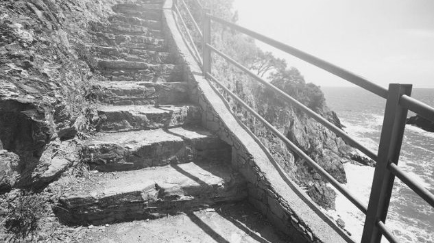 Featured Images - 20 step Process for writing your novel. Photo of stone steps overlooking the sea. Image from GraphicStock