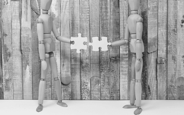 Featured Images - Photo of two artist dummies holding jigsaw pieces that connect. Image from Pixabay