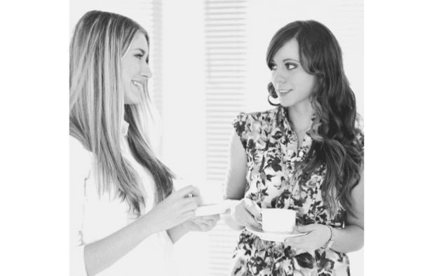 Featured Images - Two women talking over coffee.