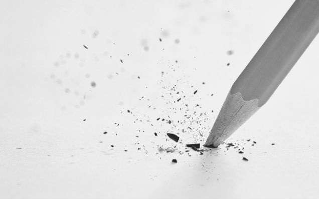 Featured Images - close up photo of a pencil on paper, with the lead snapped. Image from GraphicStock