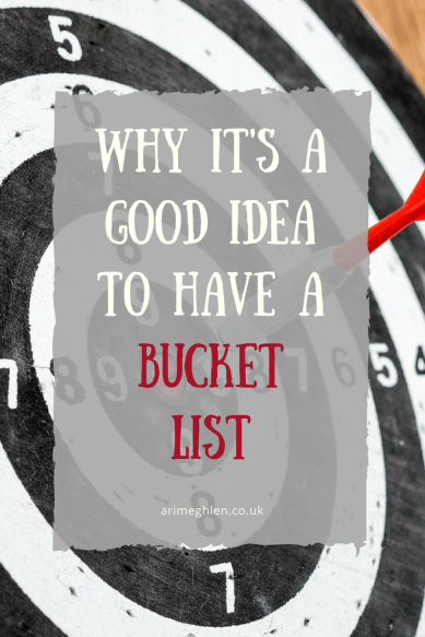 banner Why it's a good idea to have a bucket list - image of a dart board with a dart in the bullseye