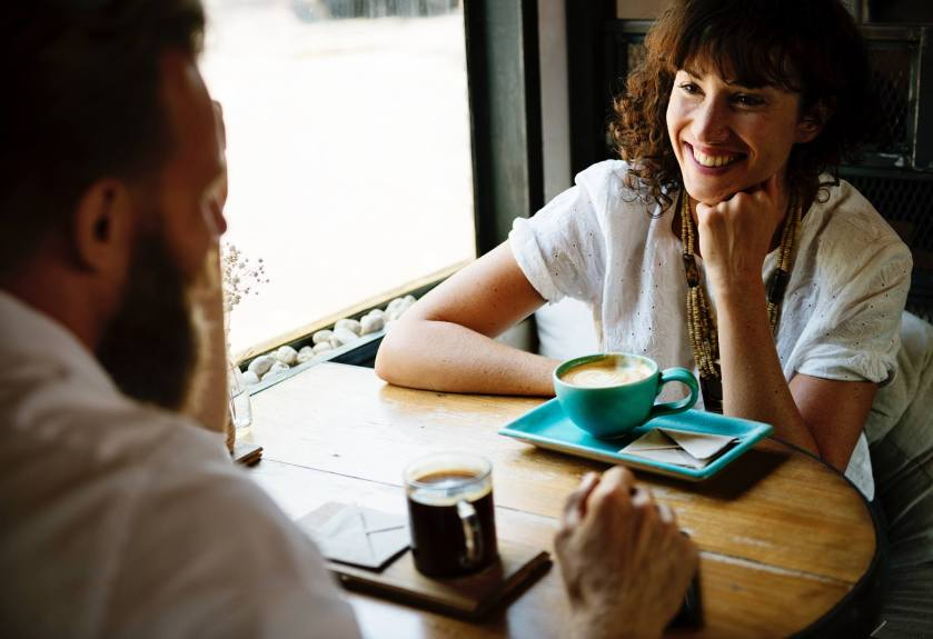 Comunication. Two people enjoying a coffee together
