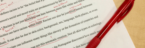Page of edits, red pen scribbles. Title Image for Editing Page