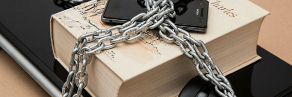 Image: Protect your work. Laptop, book and phone padlocked