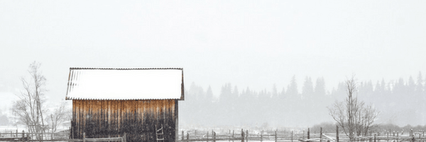 Image: Simple wooden house in snowy field