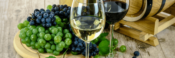 Image: Glasses of wine, bunches of grapes & a barrel