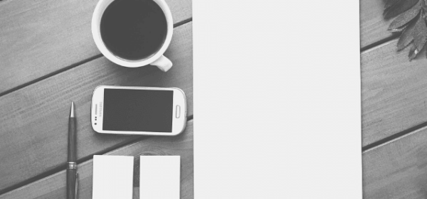 Featured Images - Flat lay image of paper, phone, cup and pen on a desk. Image from Pixabay