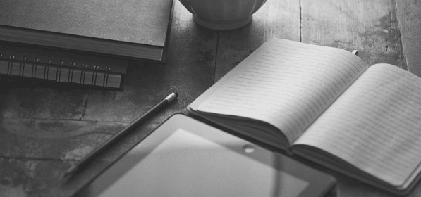 Featured Images - Notepard, table, cup and pen on a desk