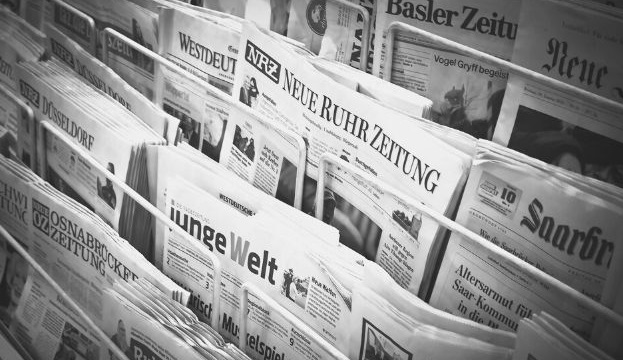 Featured Image - racks of newspapers - image from Pixabay