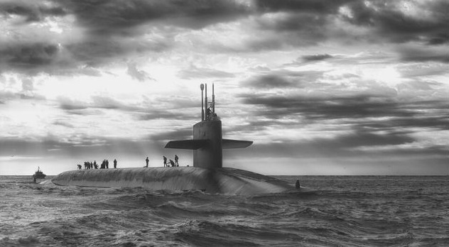 Featured Image - Submarine above the water with men on top. Image from Pixabay