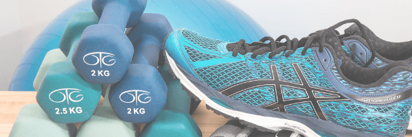 Image of dumbbels and running shoes to symbolise health