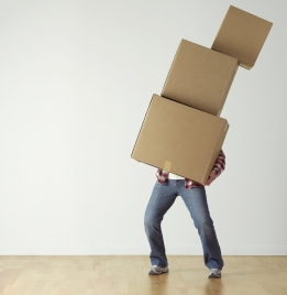 Moving house. Image: Man carrying boxes