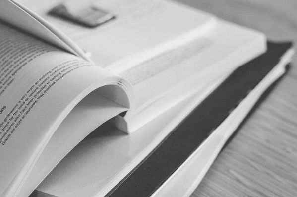Featured Images - Books open with sticky tabs. Image from Pixabay