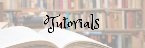 Tutorials page banner. Image of library and an open book. Image from Pixabay