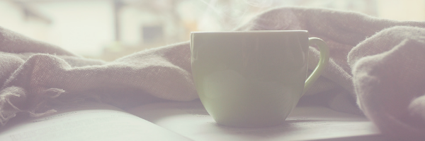 Coffee cup resting on a book, warm blanket.  Relax, read, chill.  Image from pixabay