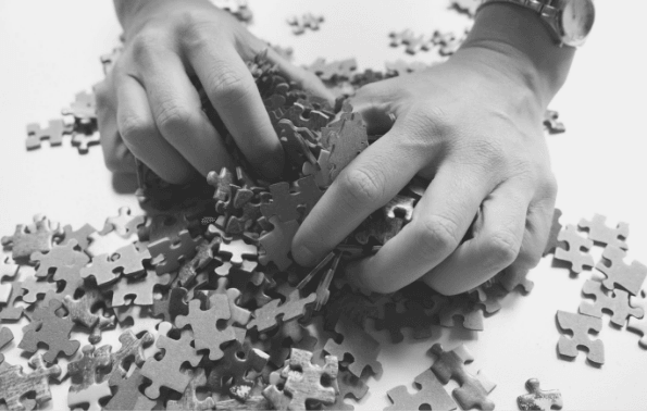 Featured-Images- hands grabbing at jigsaw pieces. Image from Pixabay