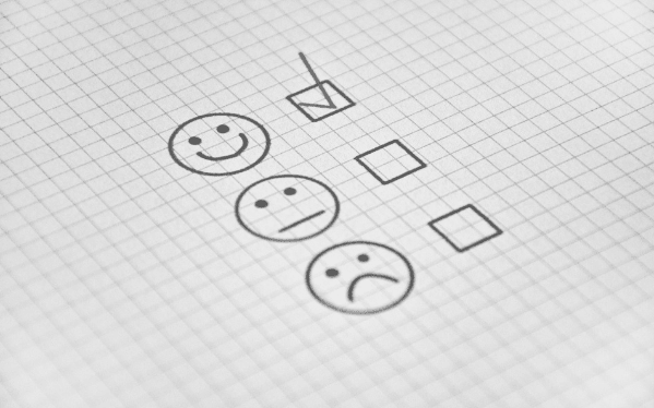 Featured-Images--Smiley face, neutral face, sad face. Tick next to the smiley face. Image from Pixabay