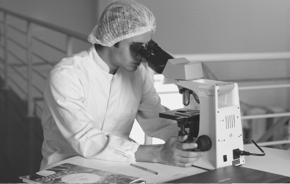 Featured Image for Biochemist article. scientist looking through a microscope. Image from pixabay
