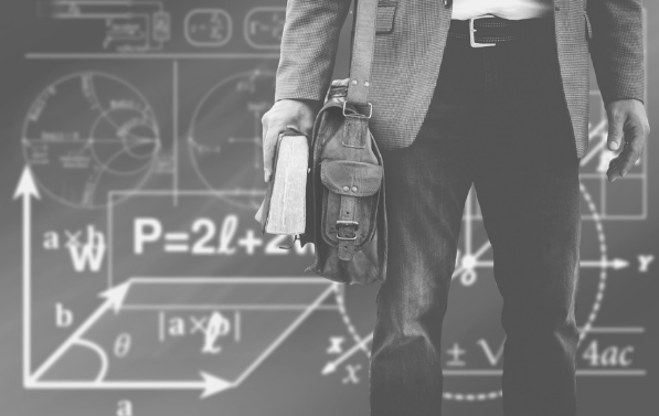 Featured image of a man with a book and satchel, standing before a chalk board full of equations.