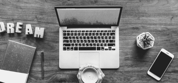 Featured Images - Laptop on a desk, person holding a mug and the word DREAM on the desk. Image from Pixabay