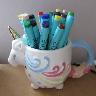 My Writerlife Series - Workstation set-up - Unicorn mug holding thick nibbed coloured pens