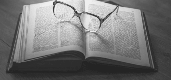 Featured Images - Book reviews. Glasses resting on an open book.