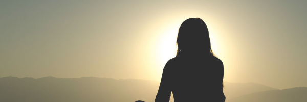 Quiet head space. Silhouette of a woman in the sunset. Image from Pixabay