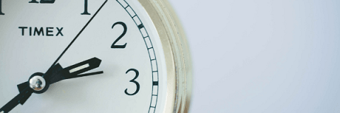 Image of a close up of part of a clock face.  Image from Pixabay