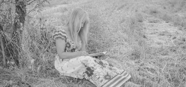 Featured Image - Adult woman reading in a field