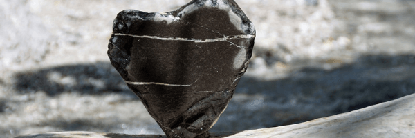 Image of a jagged black stone in the shape of a heart.  Image from Pixabay