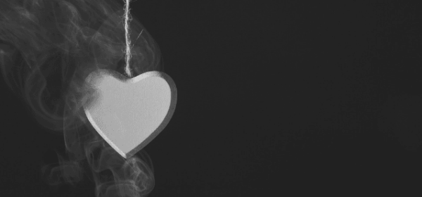 Featured Image - Wooden heart suspended on rope before a black background, surrounded by smoke. Image from Pixabay