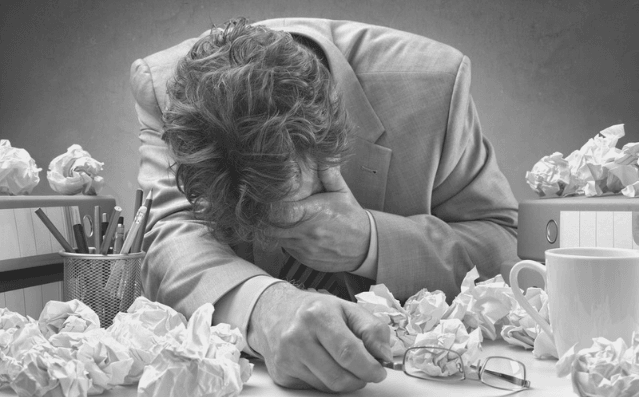 Featured Images - HAting your writing - Man surrounded by paper, head in his hands