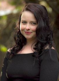 Headshot phot of author Renee April