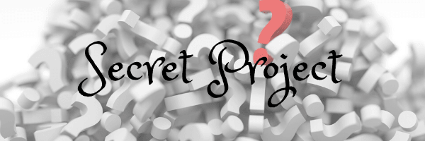 Header image Secret Project. Image of question marks. Projects currently being worked