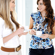 Mini image for Does Your Story Fail the Bechdel Test?  Two women talking over coffee