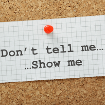 """Mini image for Show don't tell. Corkboard with a message pinned that says """"Don't tell me, show me..."""""""