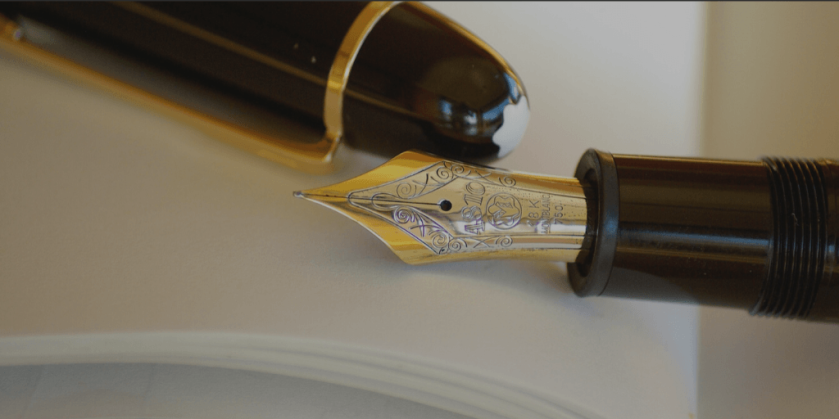 Blog Image - Fountain pen resting on an open notepad. Writing.
