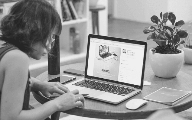 Featured Images - Woman working on a laptop blogging