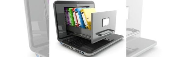 Image of a laptop with the screen sliding out like a file cabinet drawer and the drawer full of coloured binders. Image from DepositPhotos