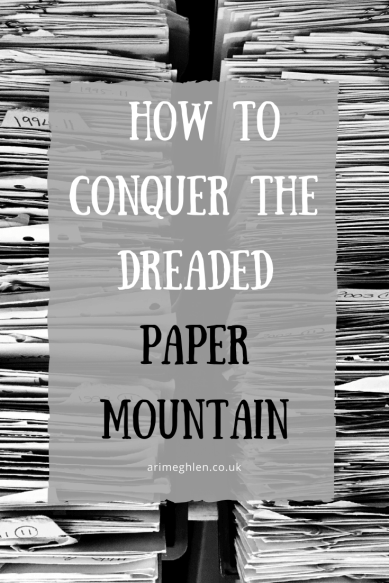 Banner Image - How to conquer the dreaded paper mountain.  Background image is two large stacks of paper.  Image from Pixabay