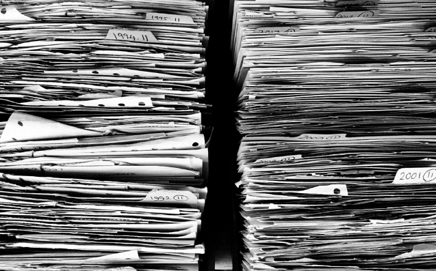 Featured Images - Black and white photo of two large stacks of paper. Image from Pixabay